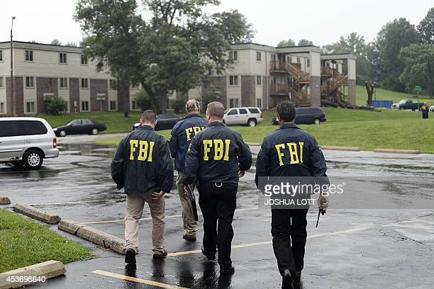 FBI Agents on August 16 investigate the shooting death of 18yearold Michael Brown at the location where he was killed on Canfield Drive in Ferguson...