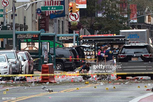FBI agents review the crime scene of remnants of bomb debris on 23rd St in Manhattan's Chelsea neighborhood on September 18 2016 in New York City An...