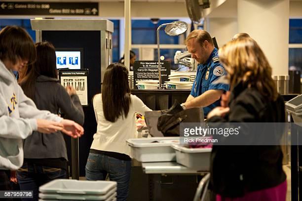 TSA agents screening travelers at Logan International Airport in Boston MA the day before Thanksgiving on November 24 2010