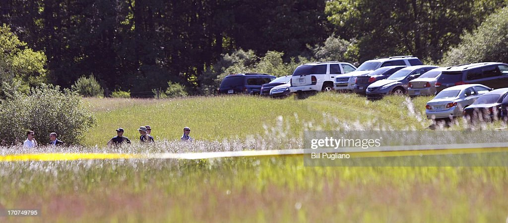 FBI agents search a field outside Detroit for the alleged remains of former Teamsters' union president Jimmy Hoffa June 17, 2013 in Oakland Township, Michigan. The agents were acting on a tip provided by Tony Zerilli, 85, a former mobster, who was released from prison in 2008. Hoffa, who had reported ties to organized crime, went missing in July of 1975.