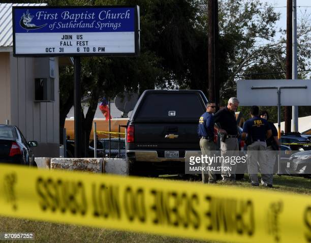 FBI agents search for clues at the entrance to the First Baptist Church after a mass shooting that killed 26 people in Sutherland Springs Texas on...
