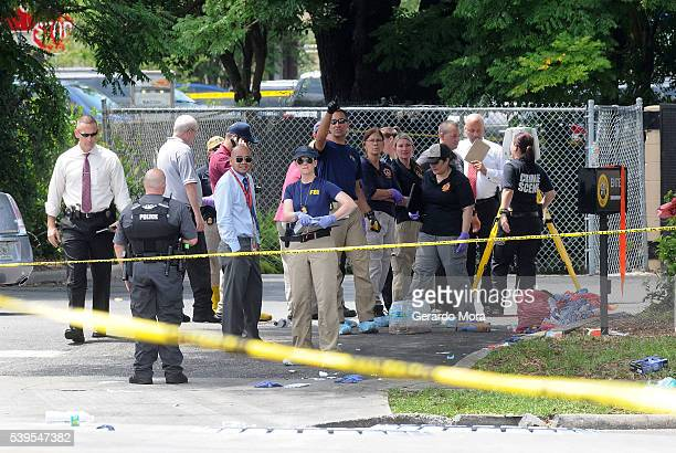FBI agents seen outside of Pulse nightclub after a fatal shooting and hostage situation on June 12 2016 in Orlando Florida The suspected shooter Omar...