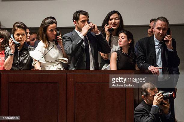 Agents speak on the phone with their clients while bidding on the art work 'Les femmes d'Alger ' painted by Pablo Picasso at Christie's on May 11...