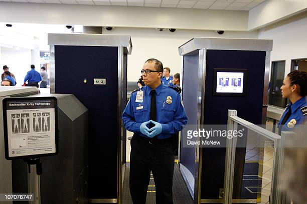 TSA agents stand near an Advanced Imaging Technology fullbody scanner at Los Angeles International Airport on November 22 2010 in Los Angeles...