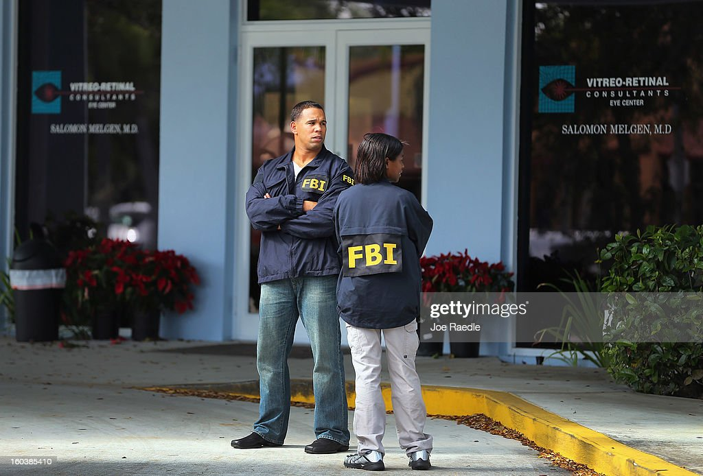 FBI agents stand outside the medical-office complex of Dr. Salomon Melgen who has possible ties to U.S. Sen. Bob Menendez (D-NJ) as they investigate on January 30, 2013 in West Palm Beach, Florida. The agents arrived last night at the medical-office complex and started hauling away potential evidence in several vans.