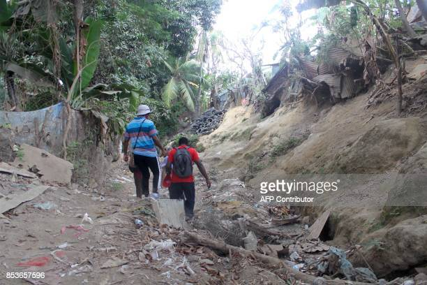 Agents the census services walk in a street of La Vigie in PetiteTerre on the Mozambique channel French archipelago of Mayotte on September 22 as a...