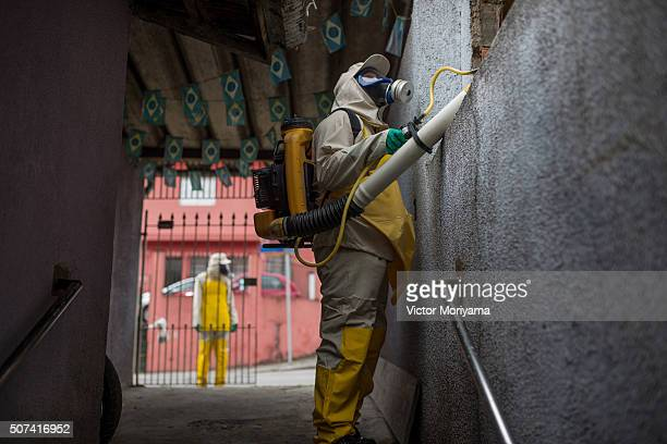 Agents working in pesticide fogging to combat the larvae of Aedes aegypti in the Butanta neighborhood The site presents cases of mosquito bite of the...