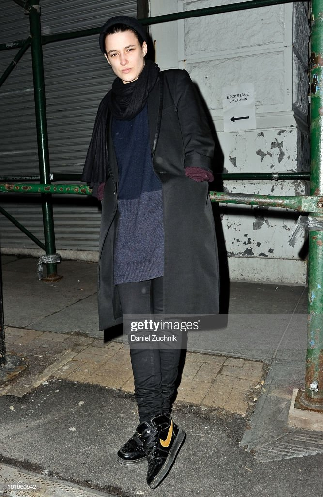 Aget, a DJ, seen outside the Proenza Schouler show wearing a Celine pull over and coat, Number (N)ine jacket and Nike shoes on February 13, 2013 in New York City.