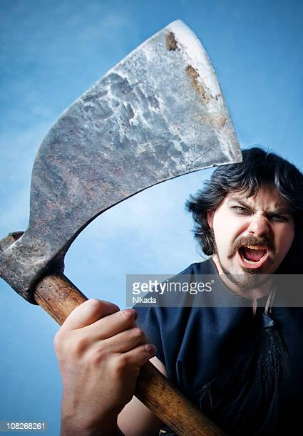 Aggressive Man Holding Large Axe