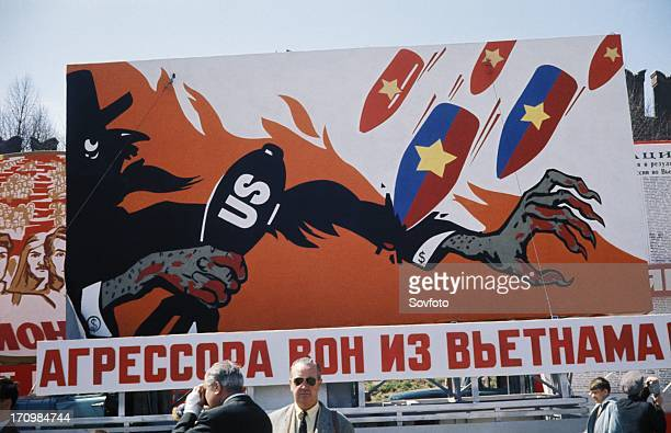 Aggressors out of vietnam' reads a cold war era billboard on a moscow street showing bombs raining down on uncle sam may 1 1968