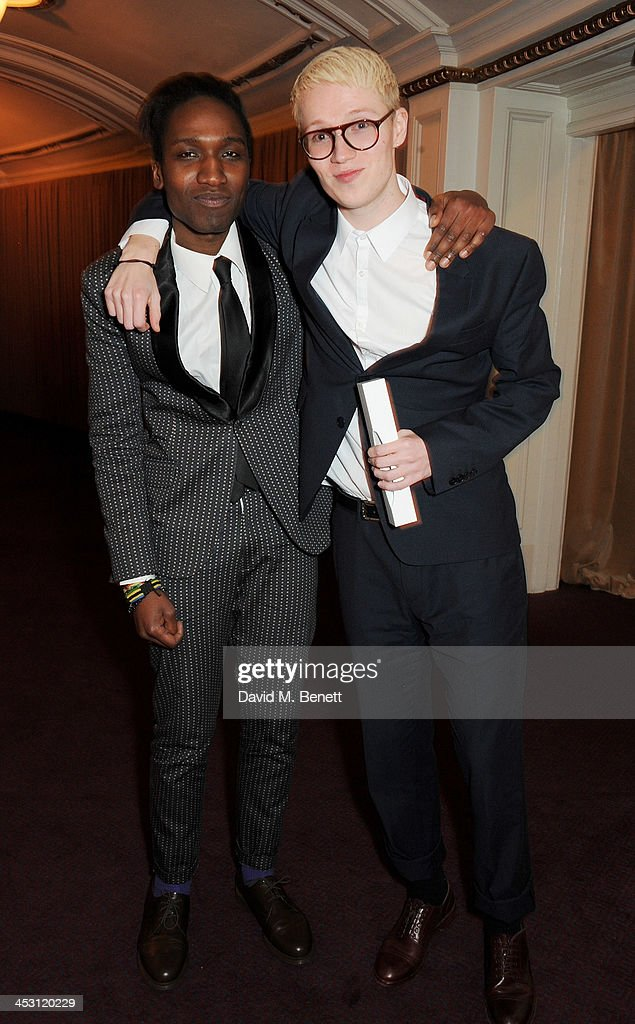 Agi Mdumulla (L) and Sam Cotton of Agi and Sam, winners of Emerging Talent, Meanswear, pose at the British Fashion Awards 2013 at London Coliseum on December 2, 2013 in London, England.