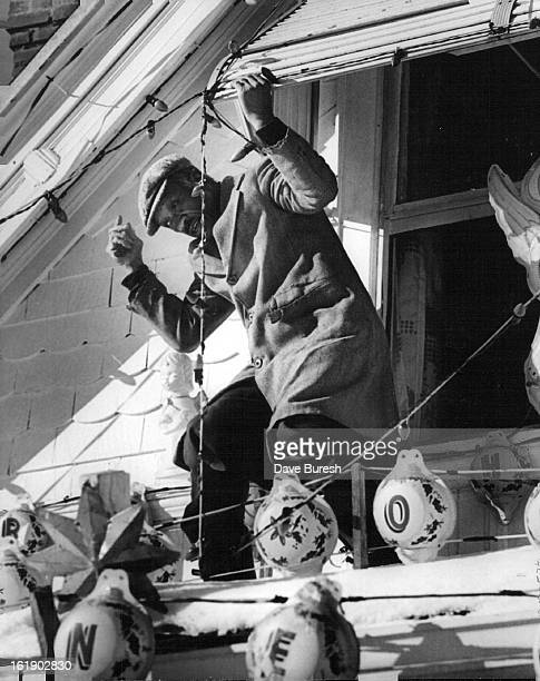 JAN 5 1973 JAN 10 1973 Agile as he works on porch roof and step ladder to take
