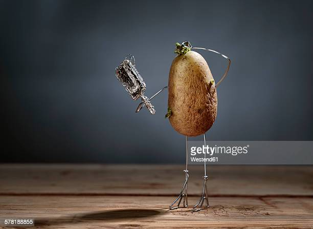 Aging potato looking into mirror