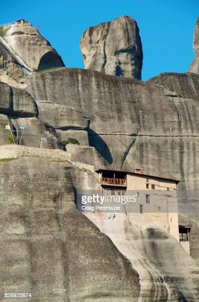 Agios Nikolaos Anapafsas Monastery amid huge rock mountains of Meteora.