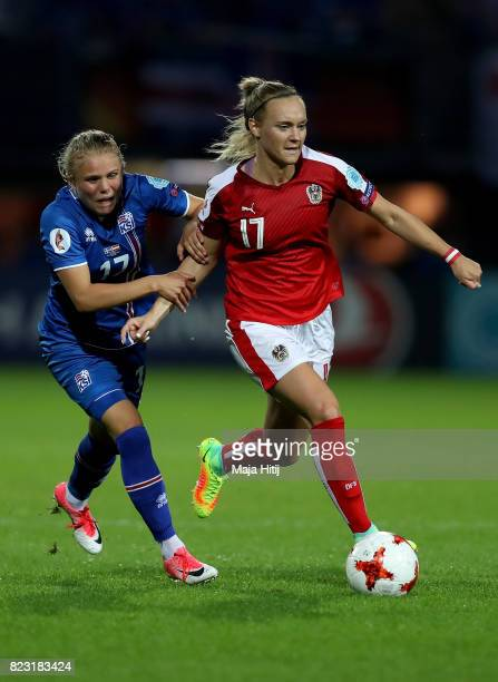 Agla Maria Albertsdottir of Iceland and Sarah Puntigam of Austria compete for the ball during the Group C match between Iceland and Austria during...