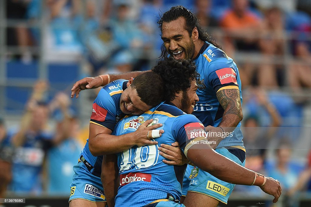 Agnatius Paasi of the Titans celebrates scoring a try with team mates during the round one NRL match between the Gold Coast Titans and the Newcastle...