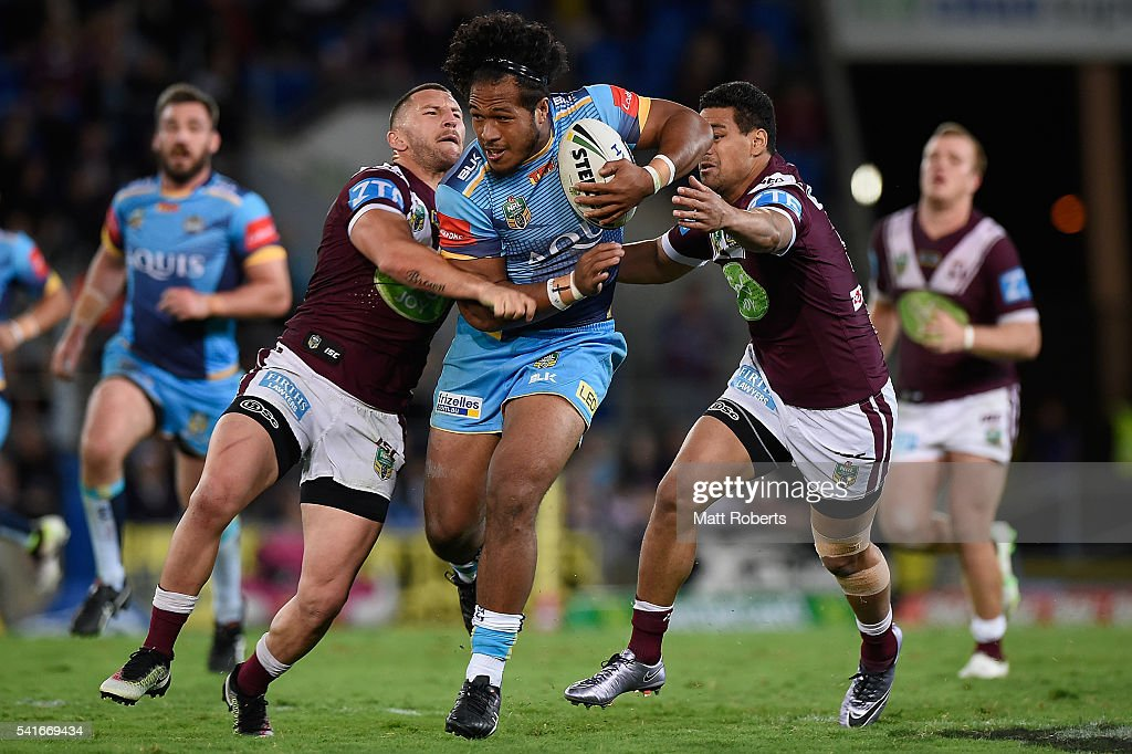 Agnatius Paasi of the Titans is tackled during the round 15 NRL match between the Gold Coast Titans and the Manly Sea Eagles at Cbus Super Stadium on June 20, 2016 in Gold Coast, Australia.