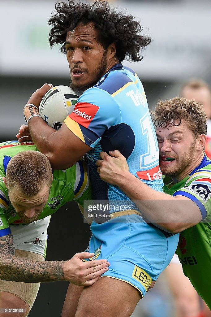 Agnatius Paasi of the Titans is tackled during the round 16 NRL match between the Gold Coast Titans and the Canberra Raiders at Cbus Super Stadium on June 26, 2016 in Gold Coast, Australia.