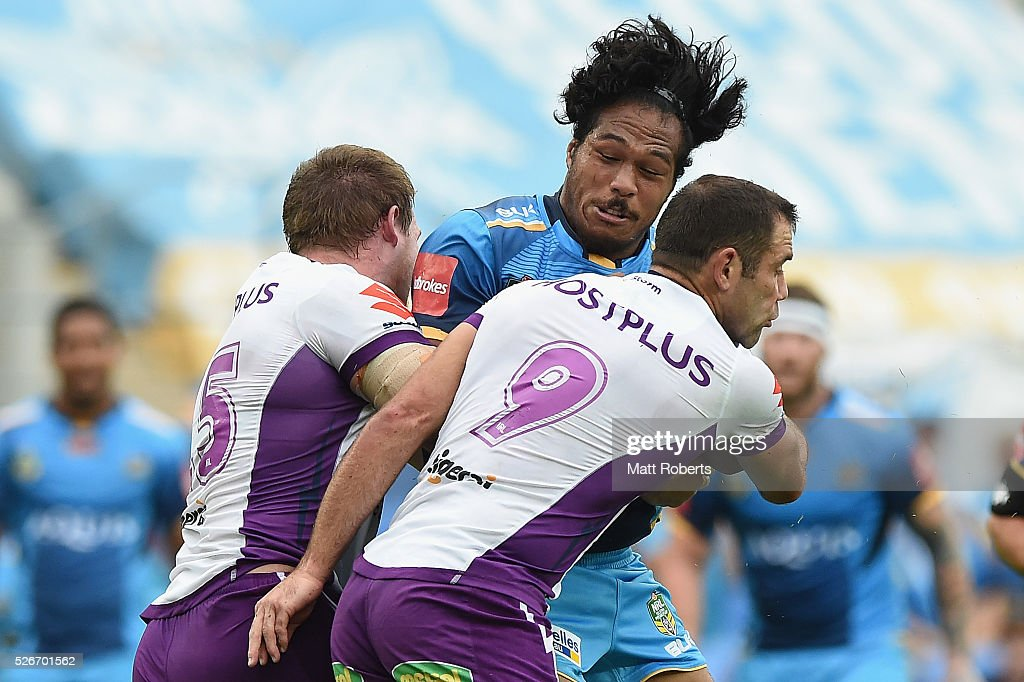Agnatius Paasi of the Titans is tackled during the round nine NRL match between the Gold Coast Titans and the Melbourne Storm on May 1, 2016 in Gold Coast, Australia.