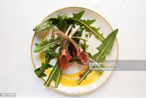 Agnello Doublerack lamb chop yellow tomato puree wild dandelion greens spring garlic English peas sea salt at Tosca for a story on how chefs are...