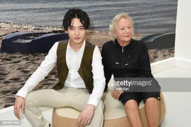 Agnes Band chinese actor Ruichang Wang pose during Agnes B Menswear Spring/Summer 2018 show as part of Paris Fashion Week ton June 25 2017 in Paris...