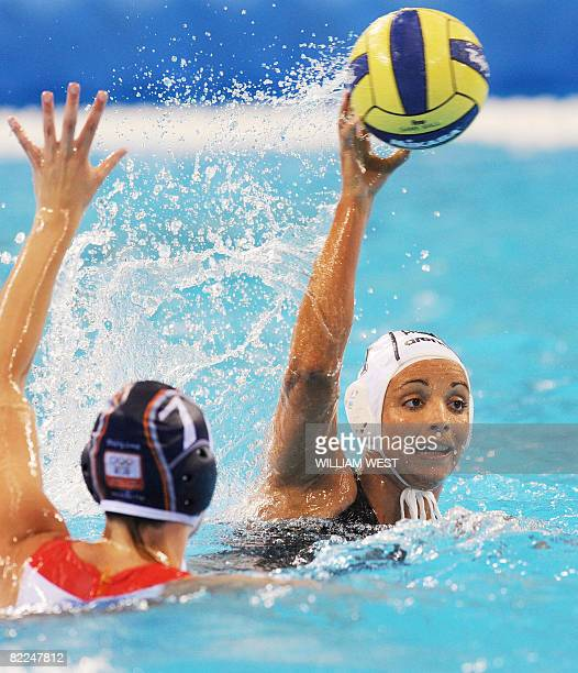 Agnes Valkai of Hungary shoots past Lefke van Belkum of the Netherlands during their 2008 Beijing Olympics Women's Water Polo match in Beijing on...