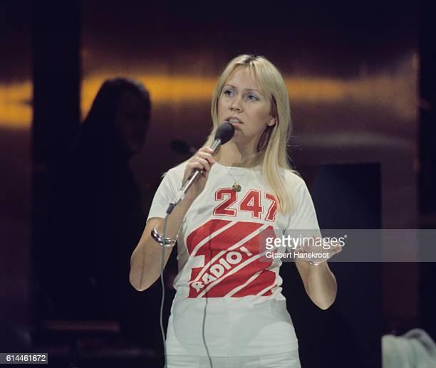Agnetha Faltskog of Abba records a Dutch TV show 'een van de acht' wearing a tshirt advertising UK radio station BBC Radio 1 The Hague Netherlands...