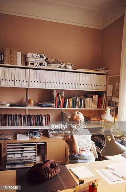Agnetha Faltskog smiling phoning an office base