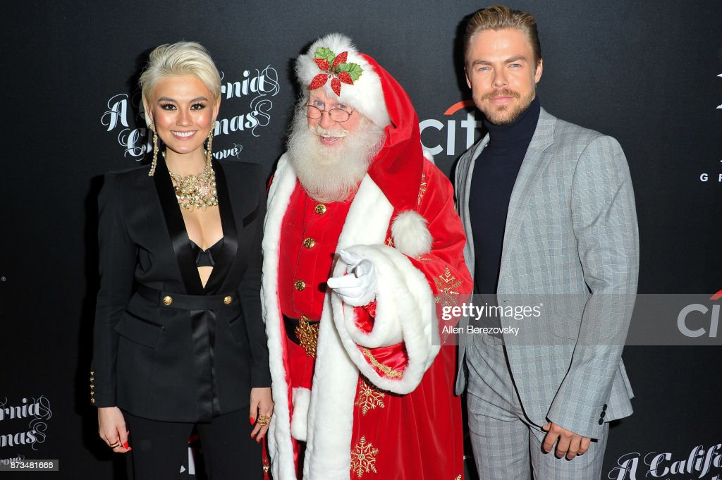 Agnez Mo, Santa Clause and Derek Hough attend A California Christmas at The Grove Presented by Citi on November 12, 2017 in Los Angeles, California.