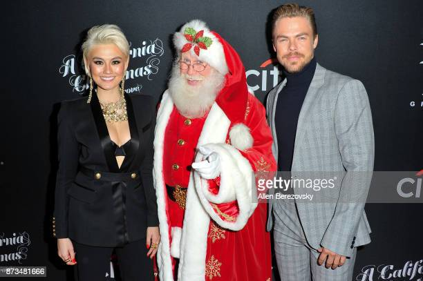 Agnez Mo Santa Clause and Derek Hough attend A California Christmas at The Grove Presented by Citi on November 12 2017 in Los Angeles California