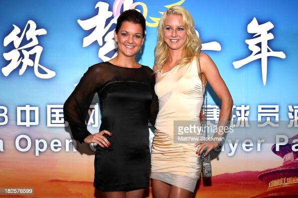 Agnieszka and Urszula Radwanska of Poland arrive on the red carpet before the player party for the 2013 China Open at the InterContinental Hotel...