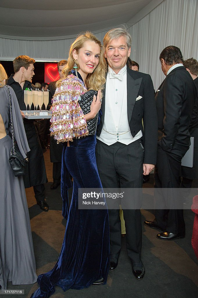 Agnieszka Butter and Charles Butter attend the 15th Annual White Tie and Tiara Ball to Benefit Elton John AIDS Foundation in Association with Chopard at Woodside on June 27, 2013 in Windsor, England. No sales to online/digital media worldwide until the 14th of July. No sales before July 14th, 2013 in UK, Spain, Switzerland, Mexico, Dubai, Russia, Serbia, Bulgaria, Turkey, Argentina, Chile, Peru, Ecuador, Colombia, Venezuela, Puerto Rico, Dominican Republic, Greece, Canada, Thailand, Indonesia, Morocco, Malaysia, India, Pakistan, Nigeria. All pictures are for editorial use only and mention of 'Chopard' and 'The Elton John Aids Foundation' are compulsory. No sales ever to Ok, Now, Closer, Reveal, Heat, Look or Grazia magazines in the United Kingdom. No sales ever to any jewellers or watchmakers other than Chopard.