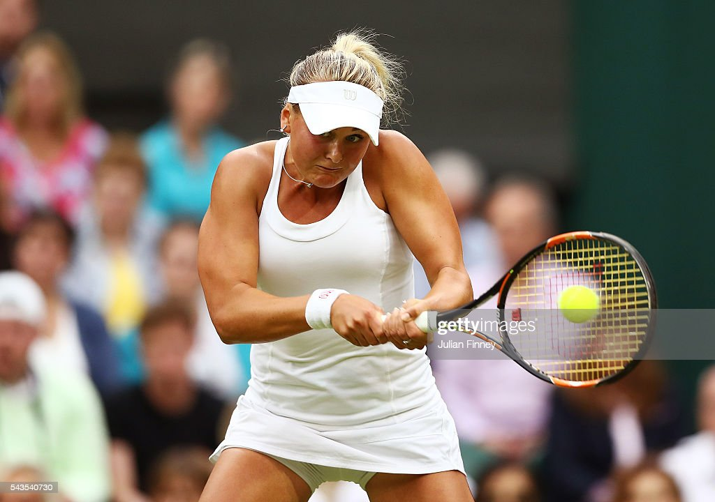 Agnieszka Radawanska of Poland plays a backhand during the Ladies Singles second round match against Kateryna Kozlova of Ukraine on day three of the Wimbledon Lawn Tennis Championships at the All England Lawn Tennis and Croquet Club on June 29, 2016 in London, England.