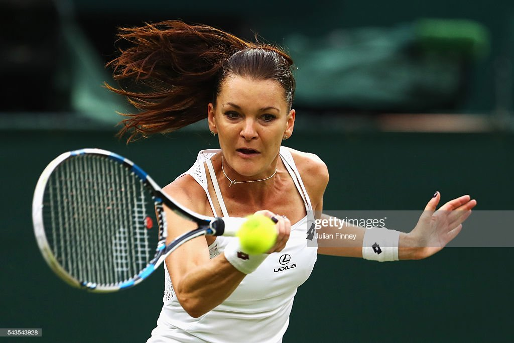 Agnieszka Radawanska of Poland plays a forehand during the Ladies Singles second round match against Kateryna Kozlova of Ukraine on day three of the Wimbledon Lawn Tennis Championships at the All England Lawn Tennis and Croquet Club on June 29, 2016 in London, England.