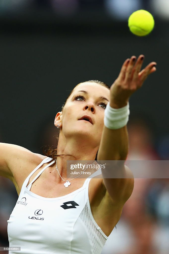 Agnieszka Radawanska of Poland serves during the Ladies Singles second round match against Kateryna Kozlova of Ukraine on day three of the Wimbledon Lawn Tennis Championships at the All England Lawn Tennis and Croquet Club on June 29, 2016 in London, England.