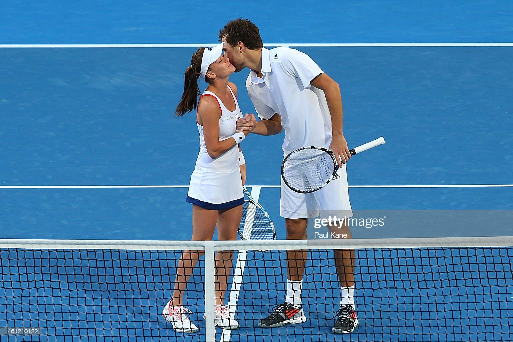 Agnieszka Radwanska and Jerzy Janowicz of Poland celebrate after winning the mixed doubles against Alize Cornet and Benoit Paire of France during day six of the 2015 Hopman Cup at Perth Arena on January 9, 2015 in Perth, Australia.