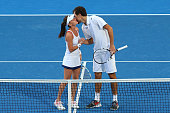 Agnieszka Radwanska and Jerzy Janowicz of Poland celebrate after winning the mixed doubles against Alize Cornet and Benoit Paire of France during day...