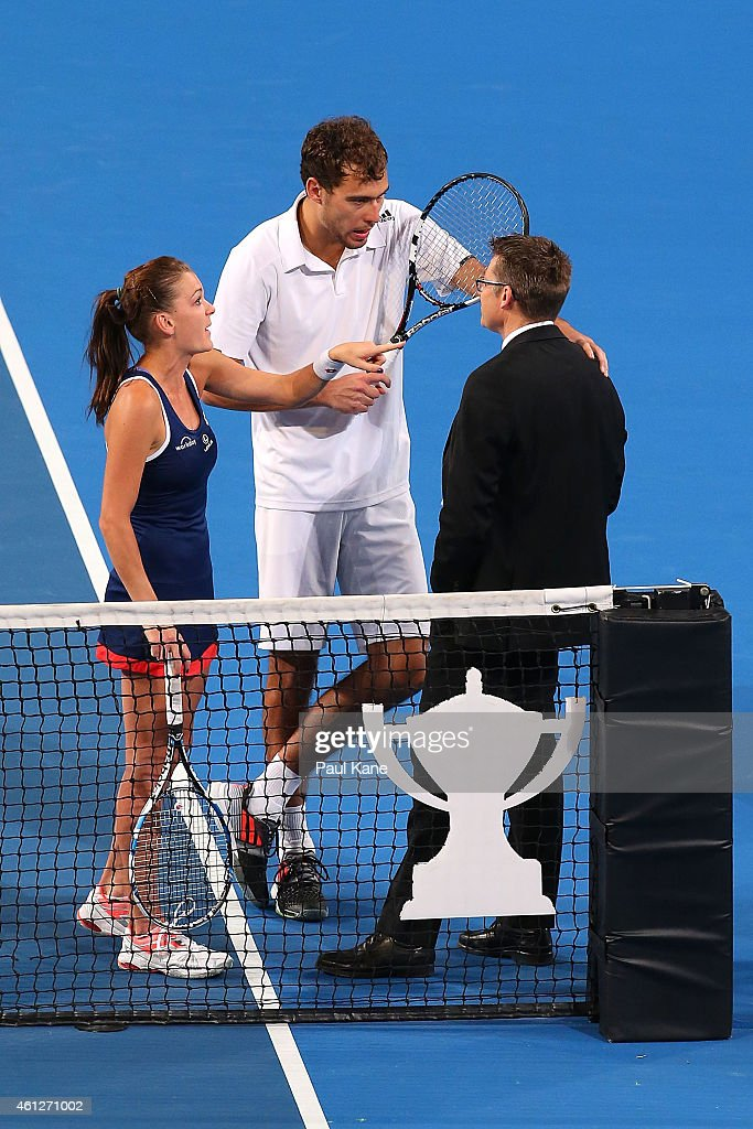 Agnieszka Radwanska and Jerzy Janowicz of Poland question a call with ITF Referee Andreas Egli in the mixed doubles final against Serena Williams and...