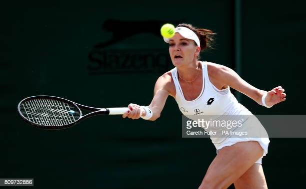 Agnieszka Radwanska in action against Christina McHale on day four of the Wimbledon Championships at The All England Lawn Tennis and Croquet Club...