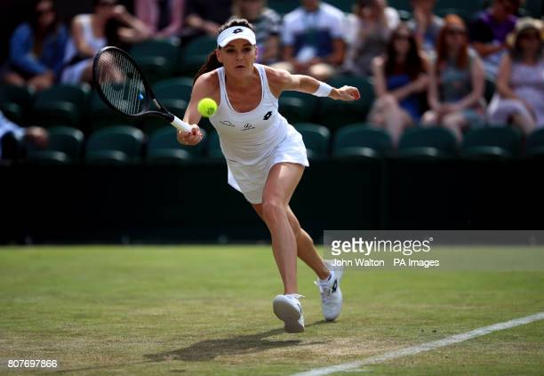 Agnieszka Radwanska in action against Jelena Jankovic on day two of the Wimbledon Championships at The All England Lawn Tennis and Croquet Club...