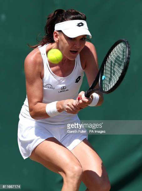 Agnieszka Radwanska in action against Svetlana Kuznetsova on day seven of the Wimbledon Championships at The All England Lawn Tennis and Croquet Club...