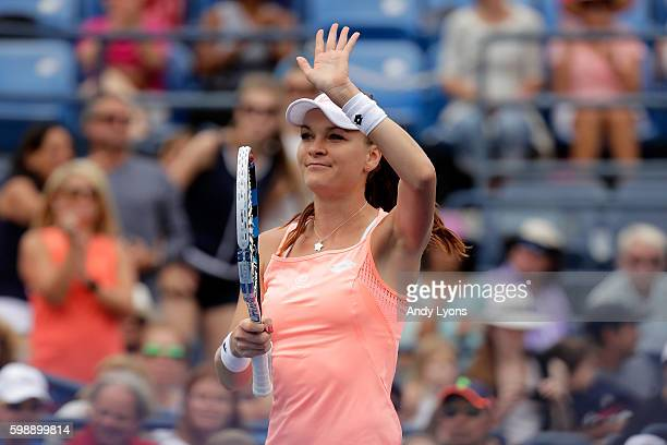 Agnieszka Radwanska of Poland acknowledges the crowd after her victory over Caroline Garcia of France during her third round Women's Singles match on...