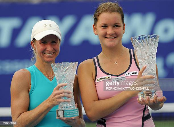 Agnieszka Radwanska of Poland and Jill Craybas of the US pose with their trophies after the Women's Open tennis tournament in Pattaya on February 10...