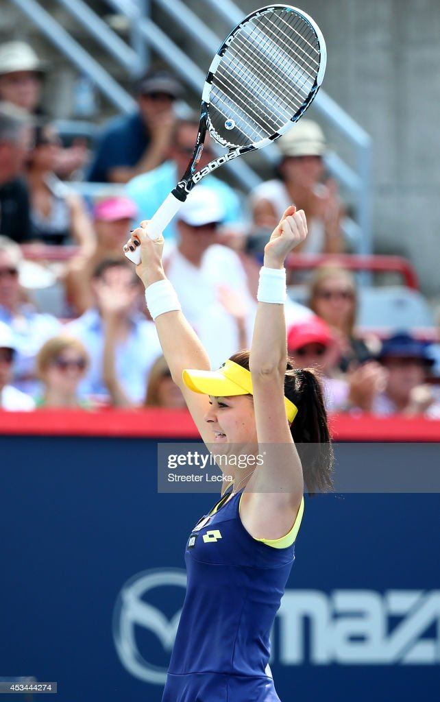 Agnieszka Radwanska of Poland celebrates after defeating Venus Williams of the USA during the women's finals match at Uniprix Stadium on August 10...