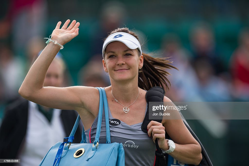 <a gi-track='captionPersonalityLinkClicked' href=/galleries/search?phrase=Agnieszka+Radwanska&family=editorial&specificpeople=579516 ng-click='$event.stopPropagation()'>Agnieszka Radwanska</a> of Poland celebrates as she walks off court after her victory against Lauren Davis of USA at Nottingham Tennis Centre on June 12, 2015 in Nottingham, England.