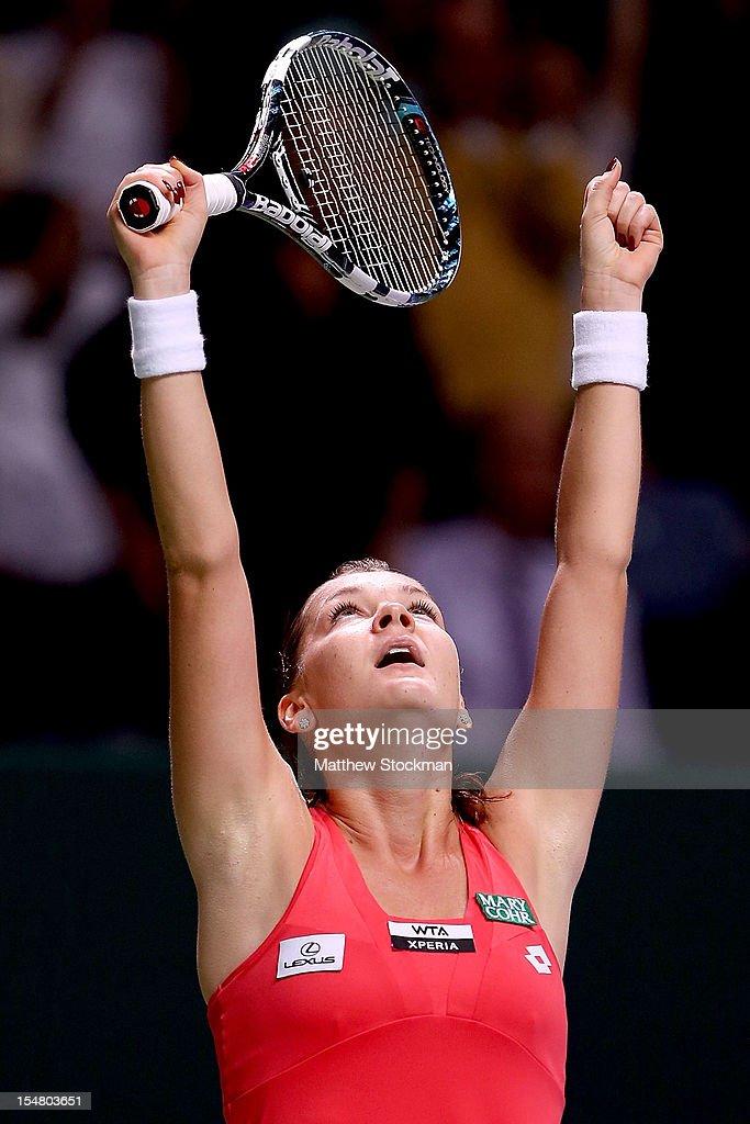 Agnieszka Radwanska of Poland celebrates match point against Sara Errani of Italy in round robin play during the TEB BNP Paribas WTA Championships at...