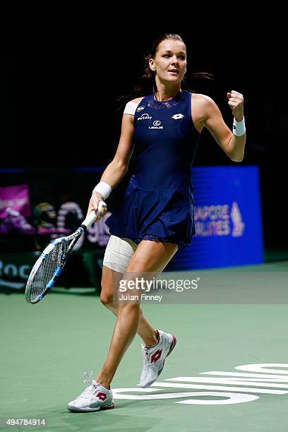 Agnieszka Radwanska of Poland celebrates match point against Simona Halep of Romania in a round robin match during the BNP Paribas WTA Finals at...