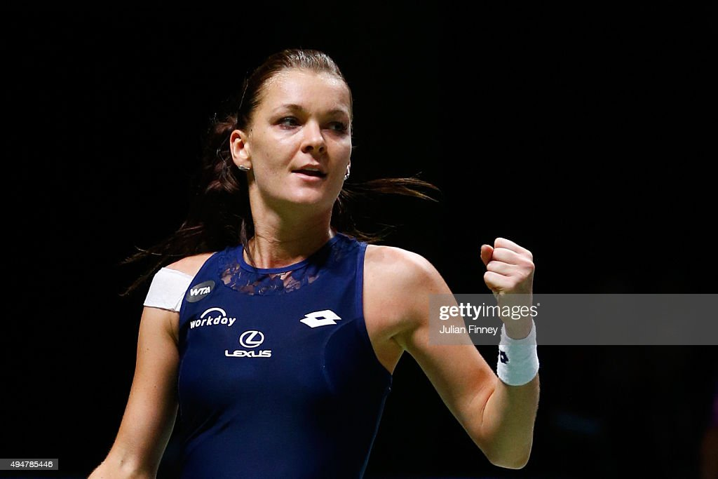 <a gi-track='captionPersonalityLinkClicked' href=/galleries/search?phrase=Agnieszka+Radwanska&family=editorial&specificpeople=579516 ng-click='$event.stopPropagation()'>Agnieszka Radwanska</a> of Poland celebrates match point against Simona Halep of Romania in a round robin match during the BNP Paribas WTA Finals at Singapore Sports Hub on October 29, 2015 in Singapore.