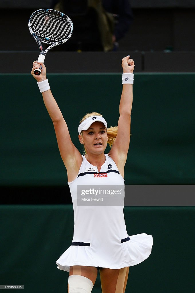 <a gi-track='captionPersonalityLinkClicked' href=/galleries/search?phrase=Agnieszka+Radwanska&family=editorial&specificpeople=579516 ng-click='$event.stopPropagation()'>Agnieszka Radwanska</a> of Poland celebrates match point during the Ladies' Singles quarter-final match against Na Li of China on day eight of the Wimbledon Lawn Tennis Championships at the All England Lawn Tennis and Croquet Club at Wimbledon on July 2, 2013 in London, England.