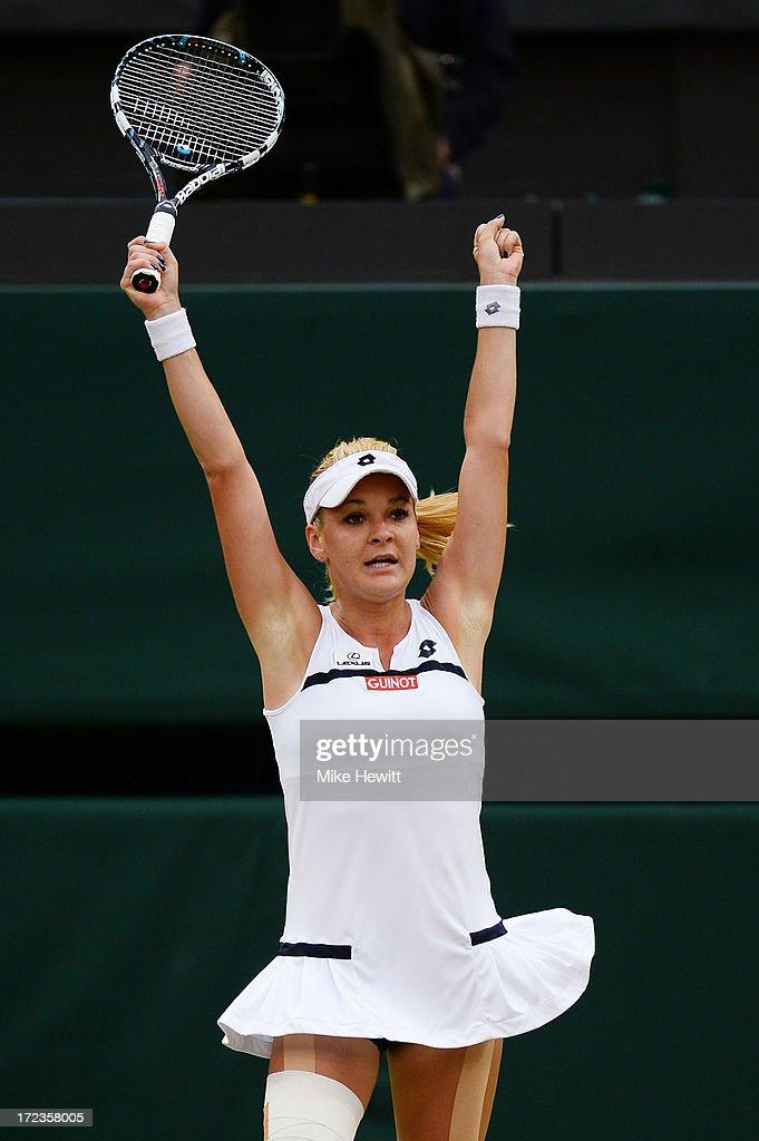 Agnieszka Radwanska of Poland celebrates match point during the Ladies' Singles quarterfinal match against Na Li of China on day eight of the...